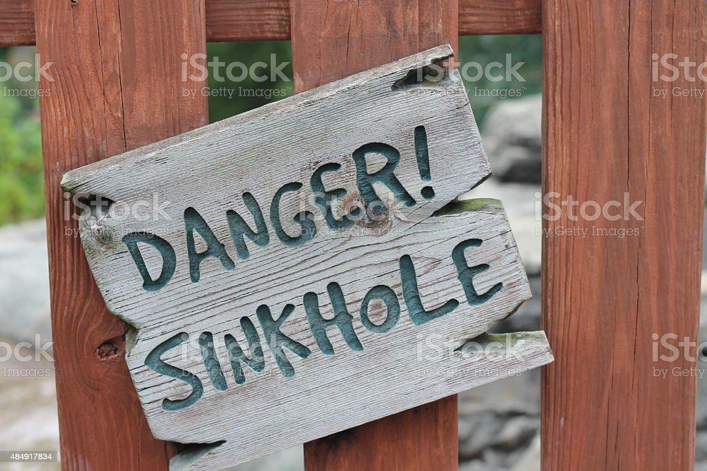 Danger Sinkhole sign stock photo
