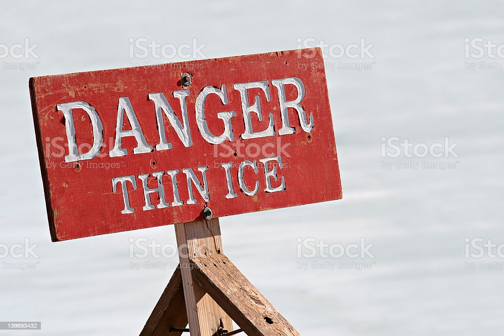 danger thin ice stock photo