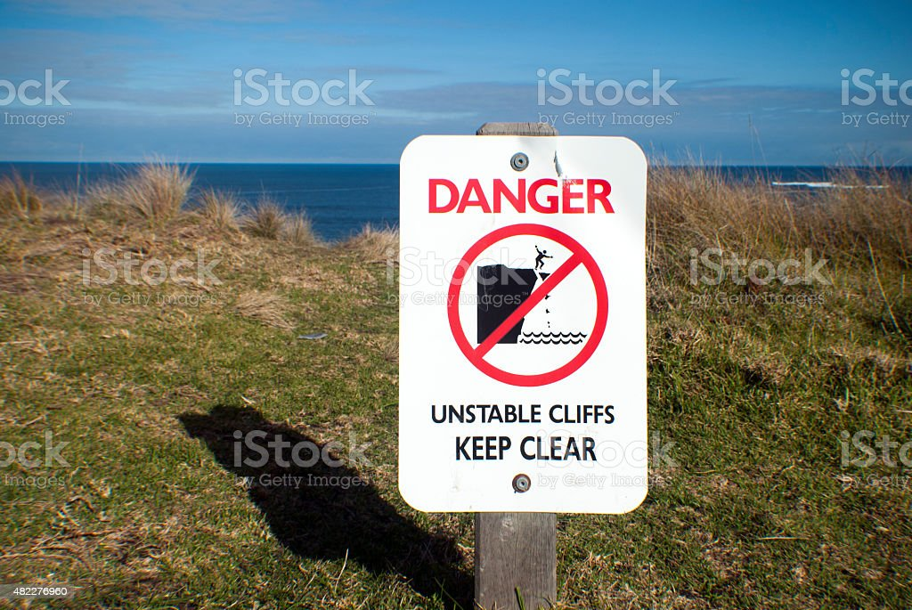 danger unstable cliffs keep clear sign near a cliff stock photo
