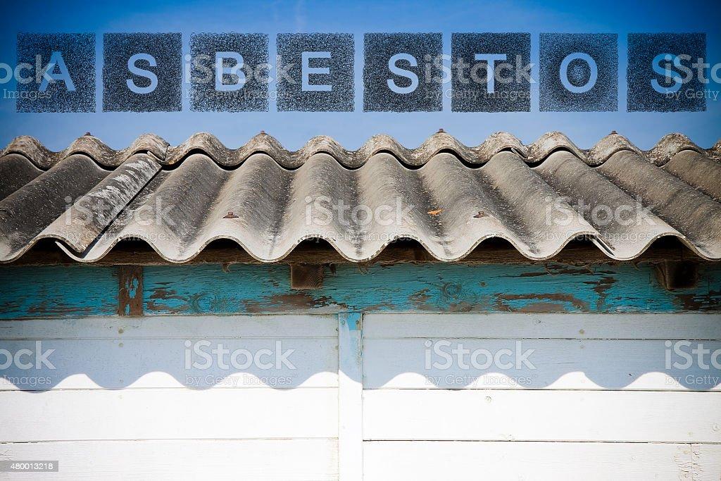 Dangerous asbestos roof. stock photo