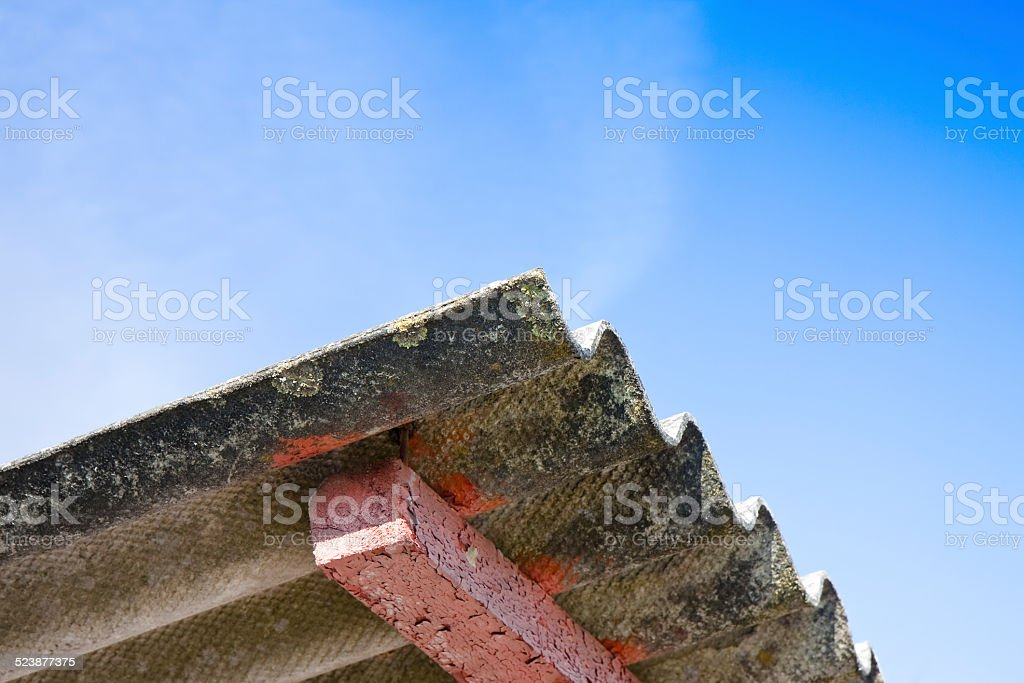 Dangerous asbestos roof with copy space stock photo