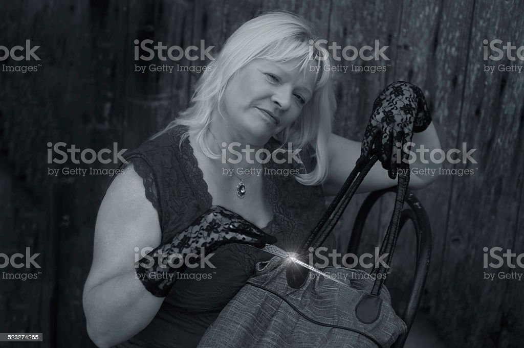 Dangerous blonde with potential weapon stock photo