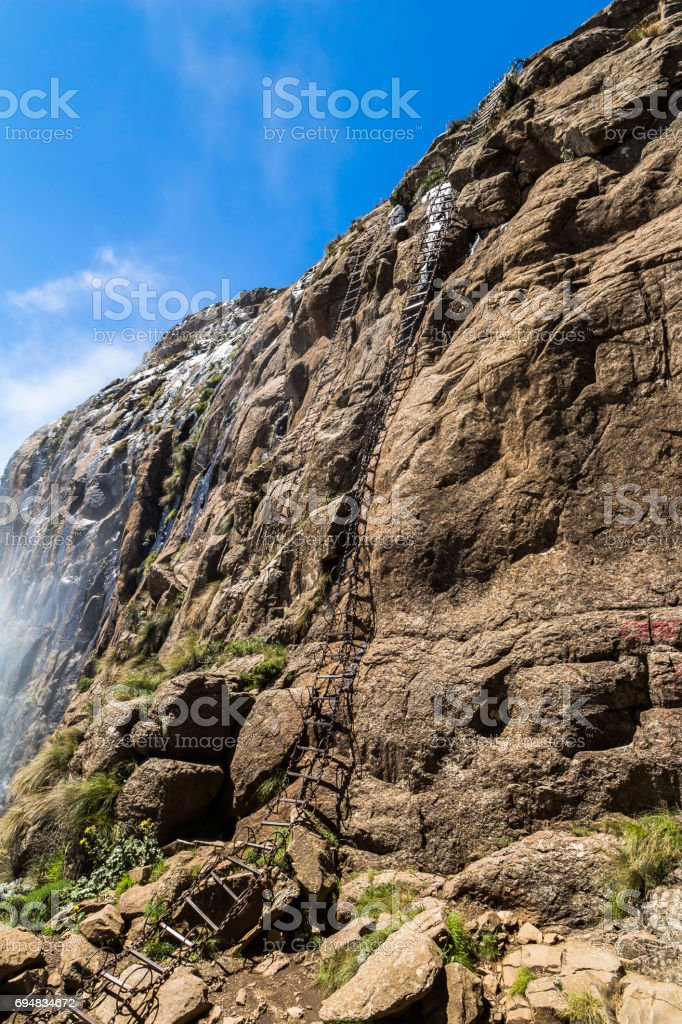 Dangerous chain ladders on the Sentinel Hike, Drakensberge, South Africa stock photo