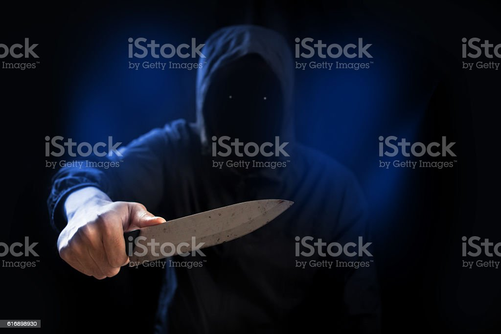 Dangerous criminal hold knife in hand. stock photo