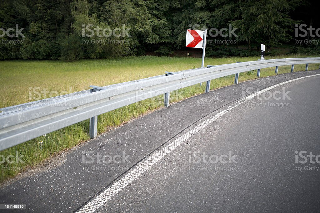 Dangerous curve on country road royalty-free stock photo