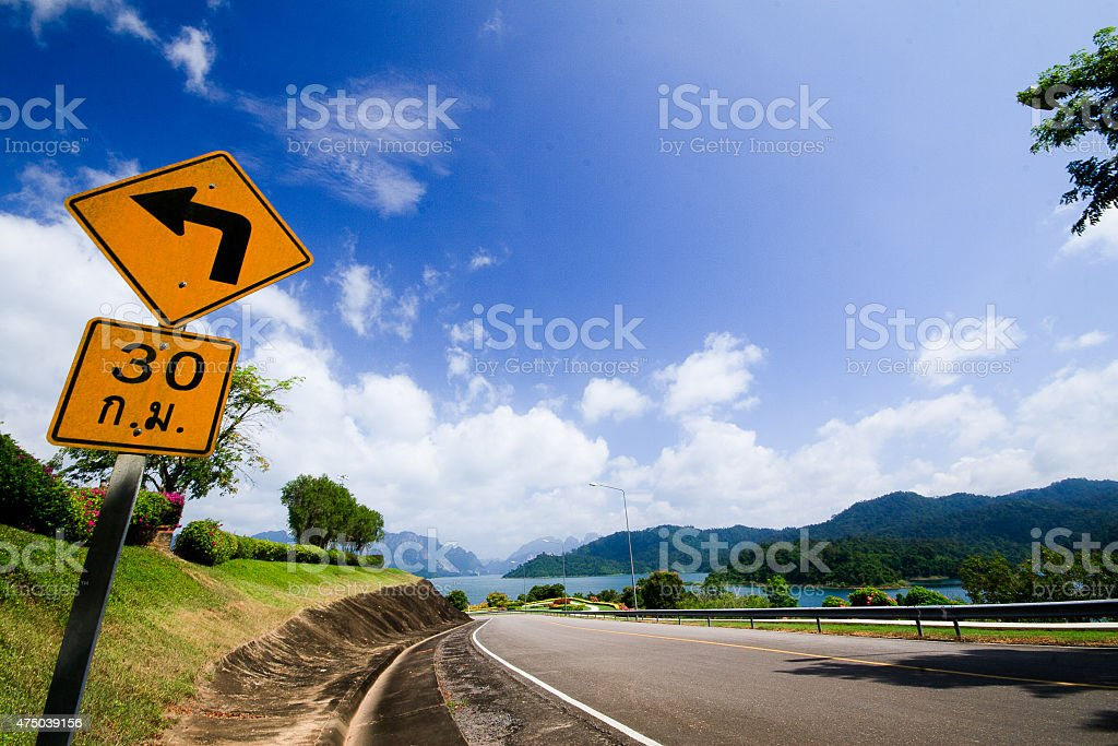Dangerous curve with traffic sign royalty-free stock photo