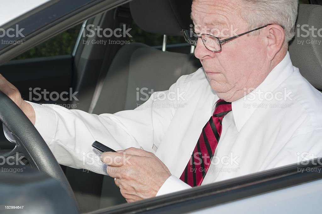 Dangerous Driver Texting and Wearing No Seat Belt royalty-free stock photo
