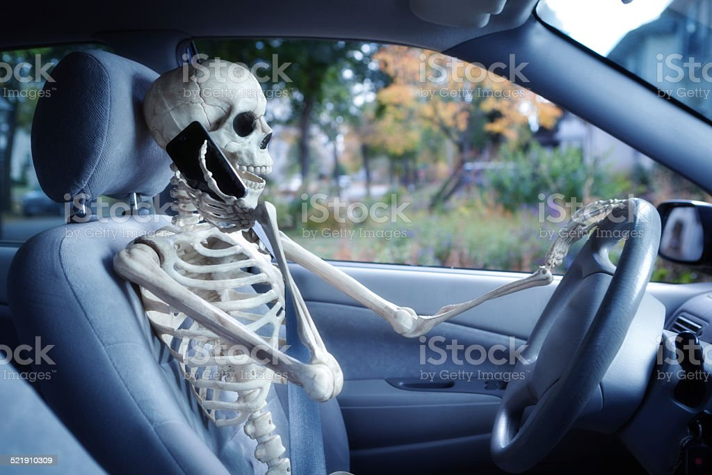 Dangerous Driver Using Mobile Phone While Driving in Car stock photo