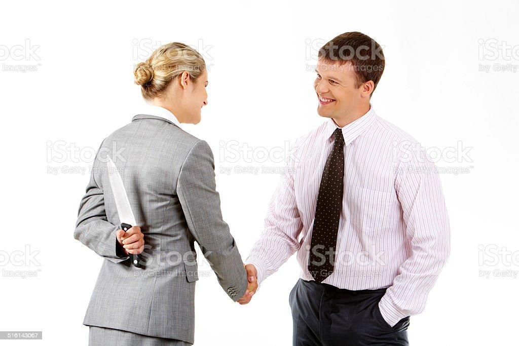 Dangerous handshake stock photo