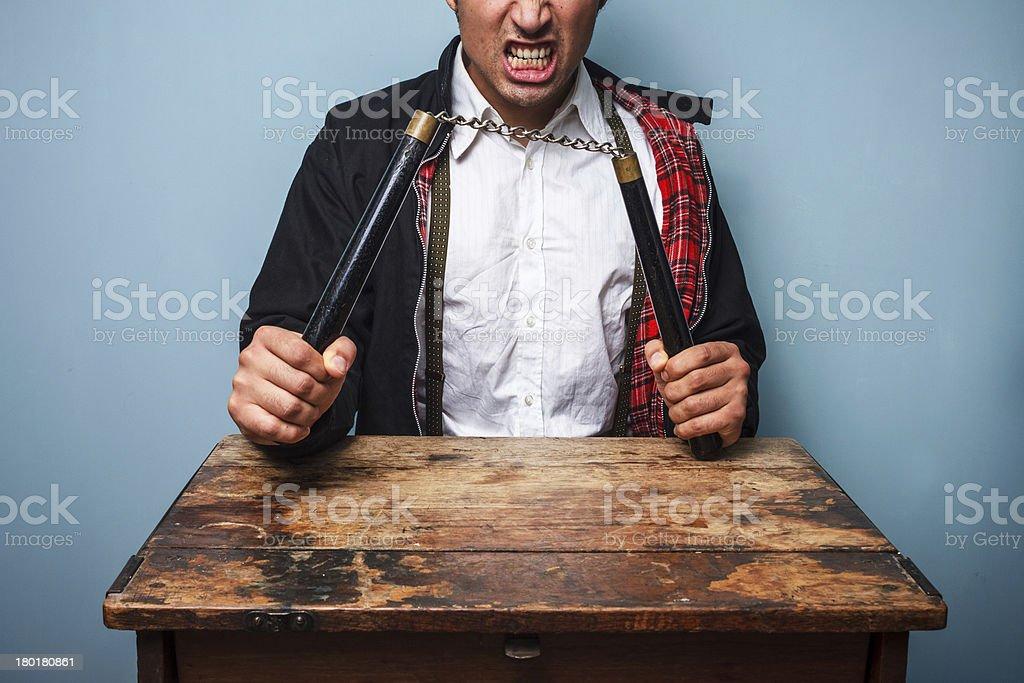Dangerous man with nunchucks royalty-free stock photo