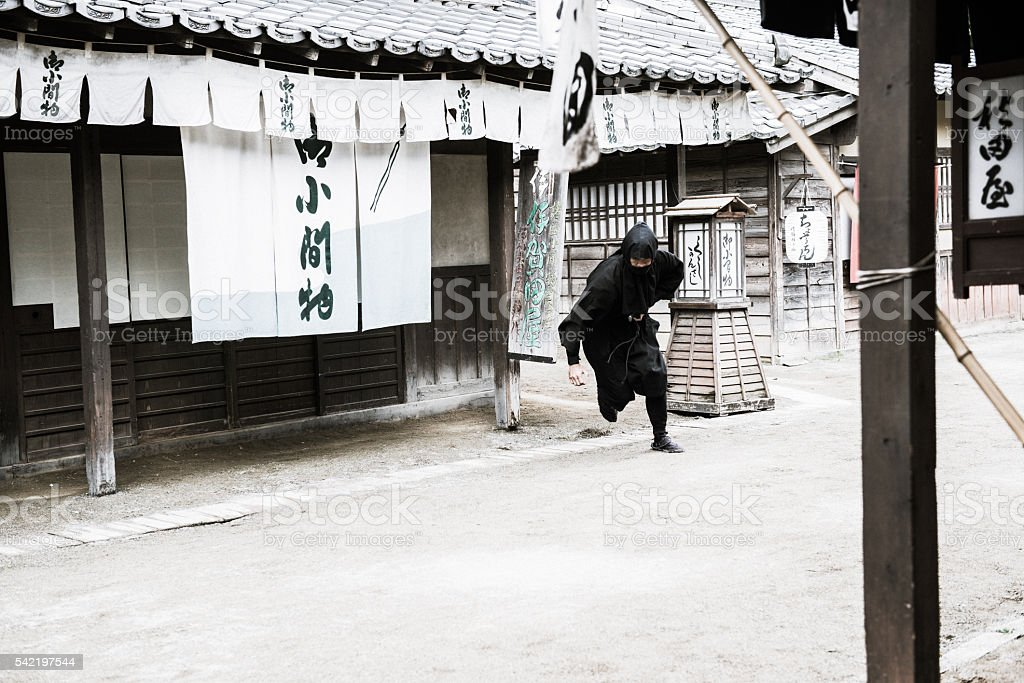 Dangerous Ninja Running in Old Town, Edo Period, Kyoto, Japan stock photo