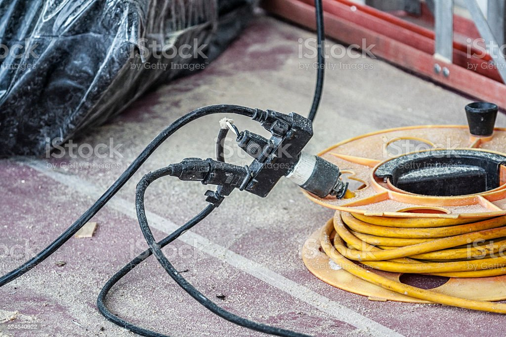 Dangerous Overloaded Electric Power Extension Cord Outlet Connector stock photo