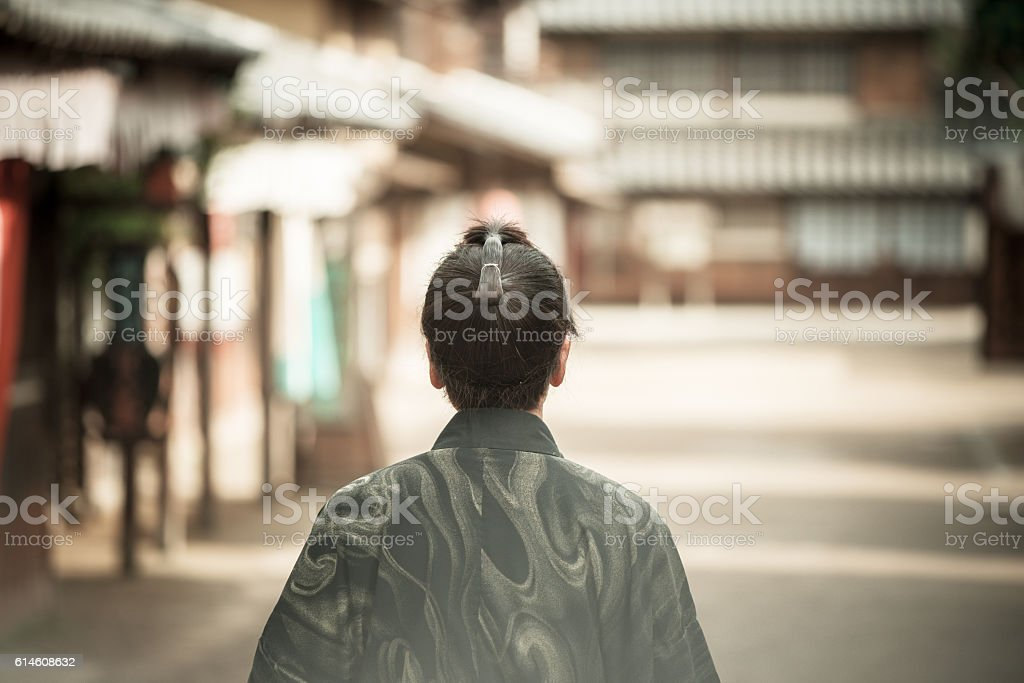 Dangerous Samurai in Japanese village looking for enemies stock photo