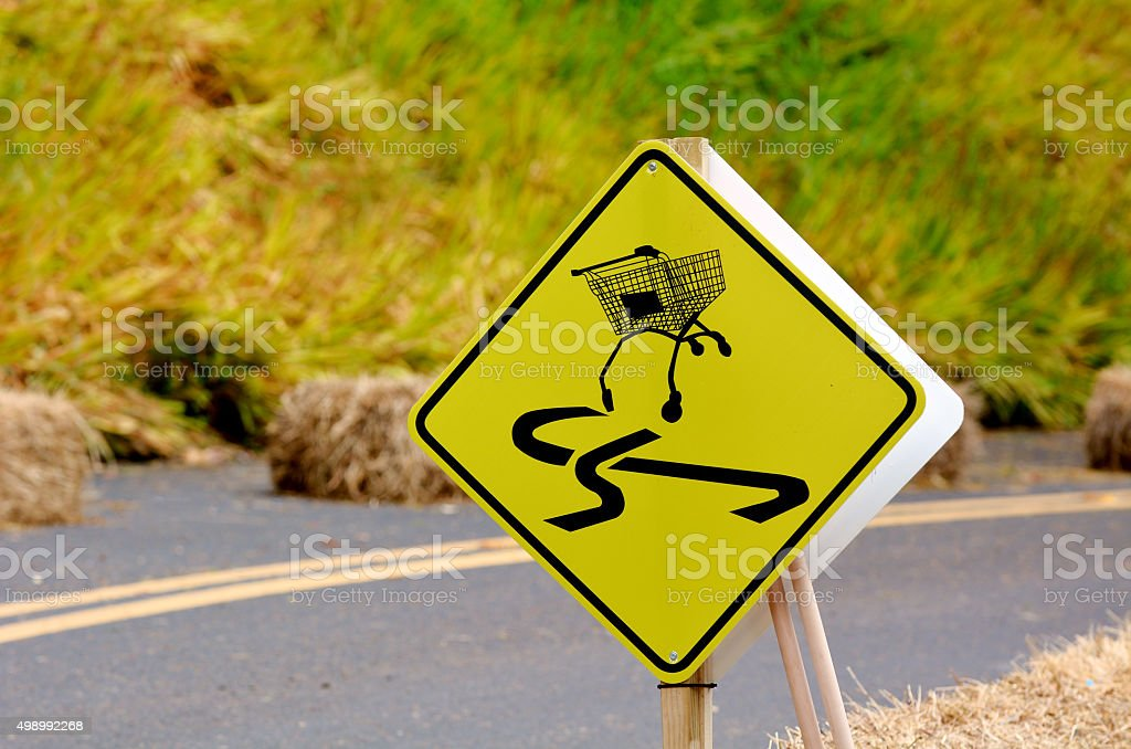 Dangerous slippery road sign of shopping trolley on the roadside stock photo