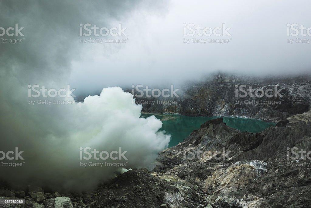Dangerous trip Inside Ijen volcano crater stock photo