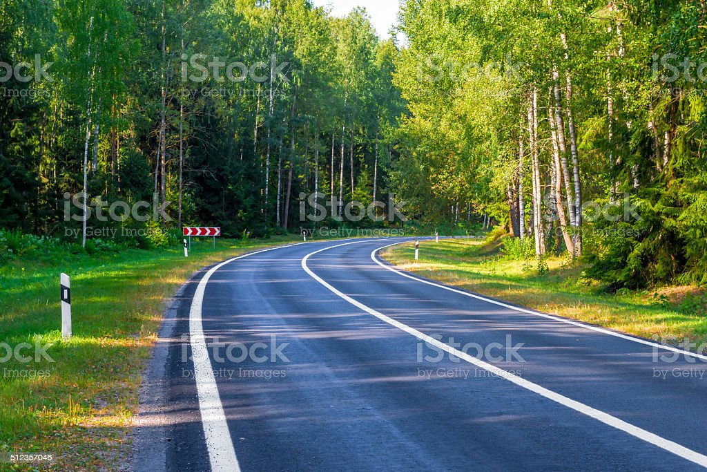 dangerous turn automobile road in the forest area stock photo