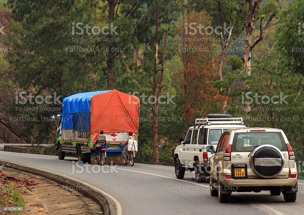 Dangerous uphill hitchhiking in Rwanda stock photo