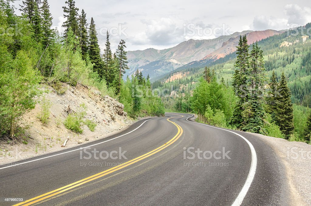 Dangerous Winding Mountain Road and Cloudy Sky stock photo