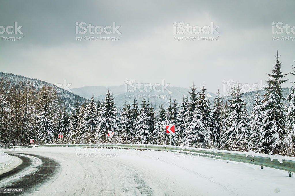 Dangerous winding road in the Carpathian mountains stock photo