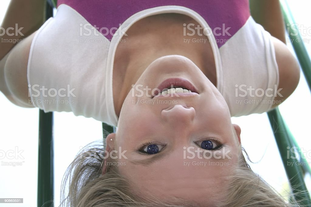 Dangling woman from bars 2 stock photo