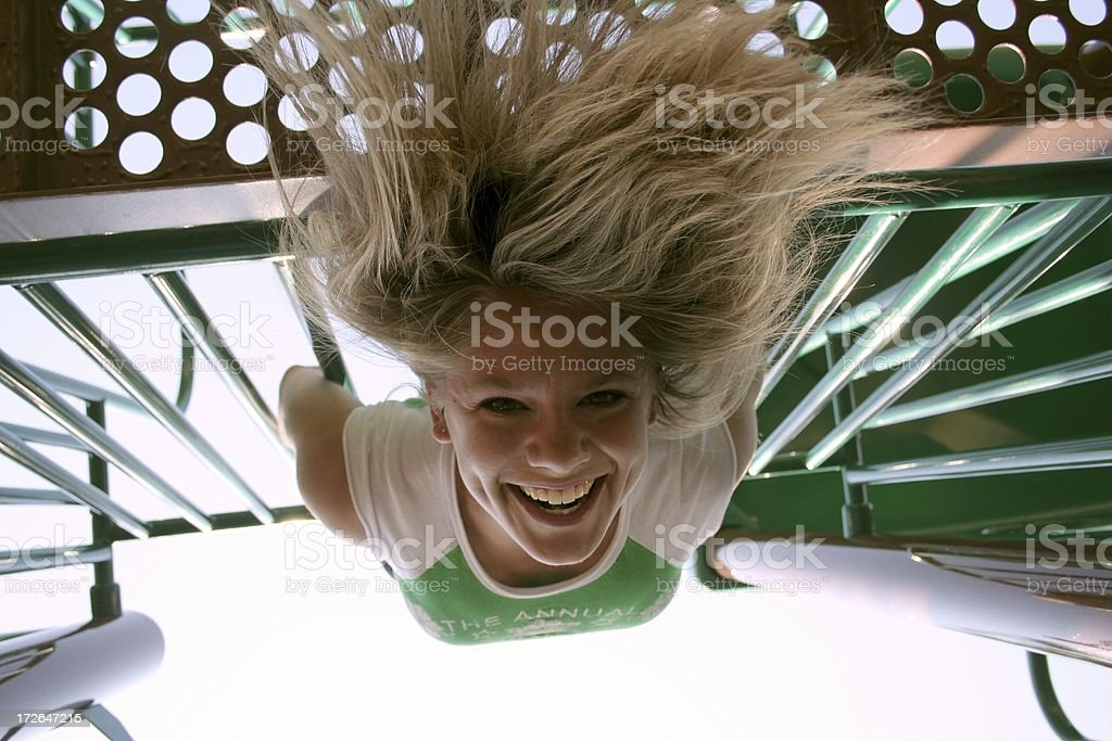 Dangling woman from bars stock photo