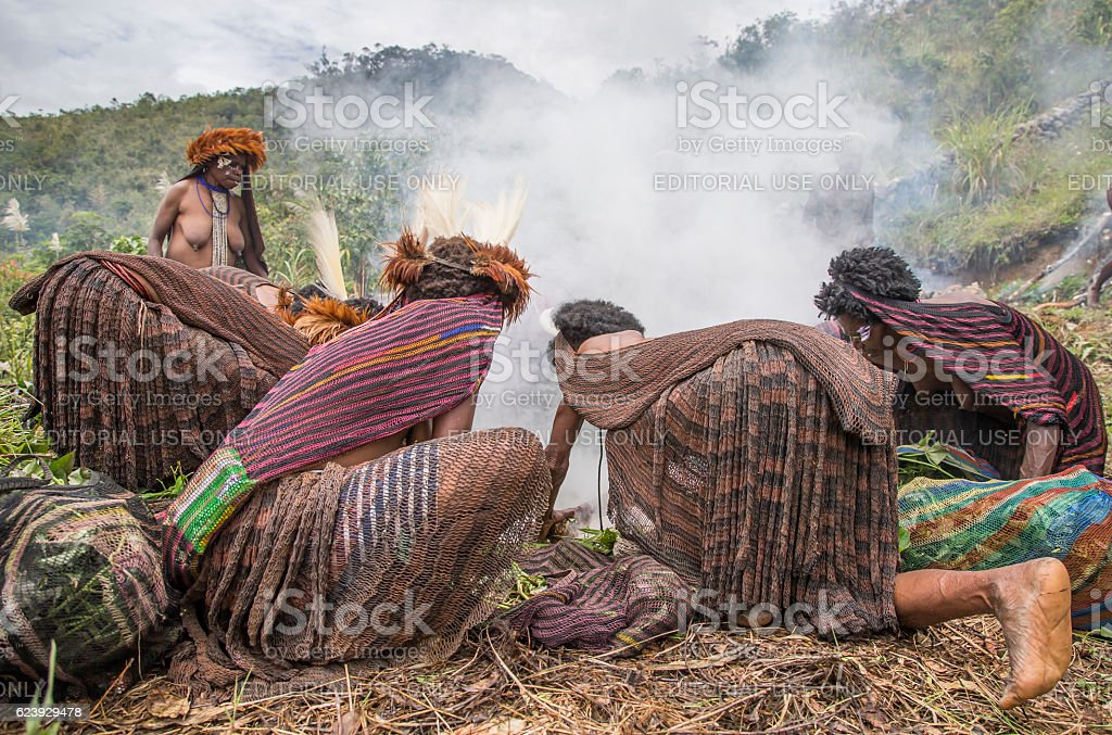 Dani tribe cooking tradition stock photo