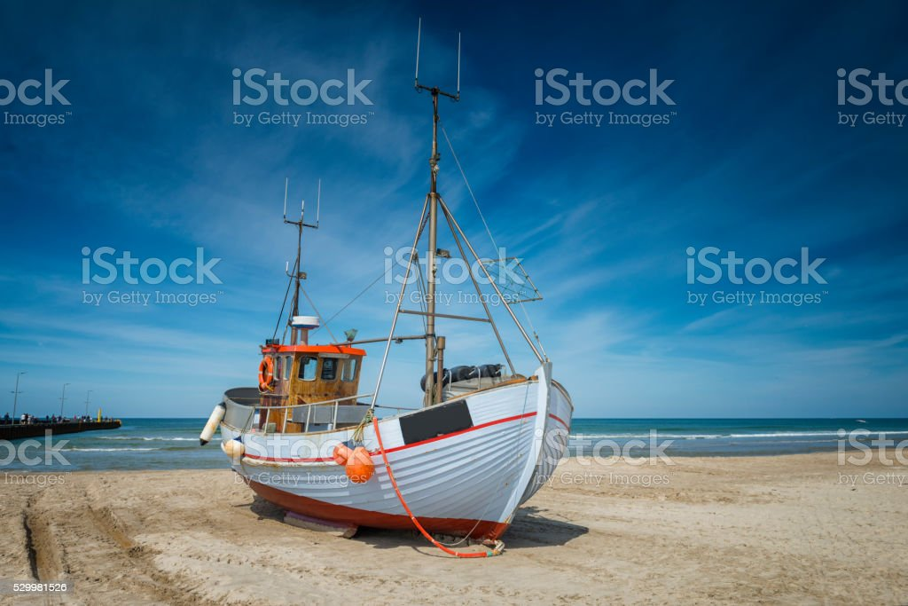 Danish Fishing boat on the beach stock photo