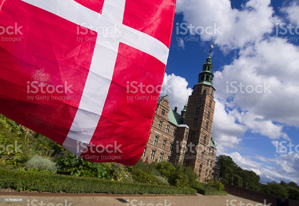 Danish flag and Rosenborg Castle stock photo