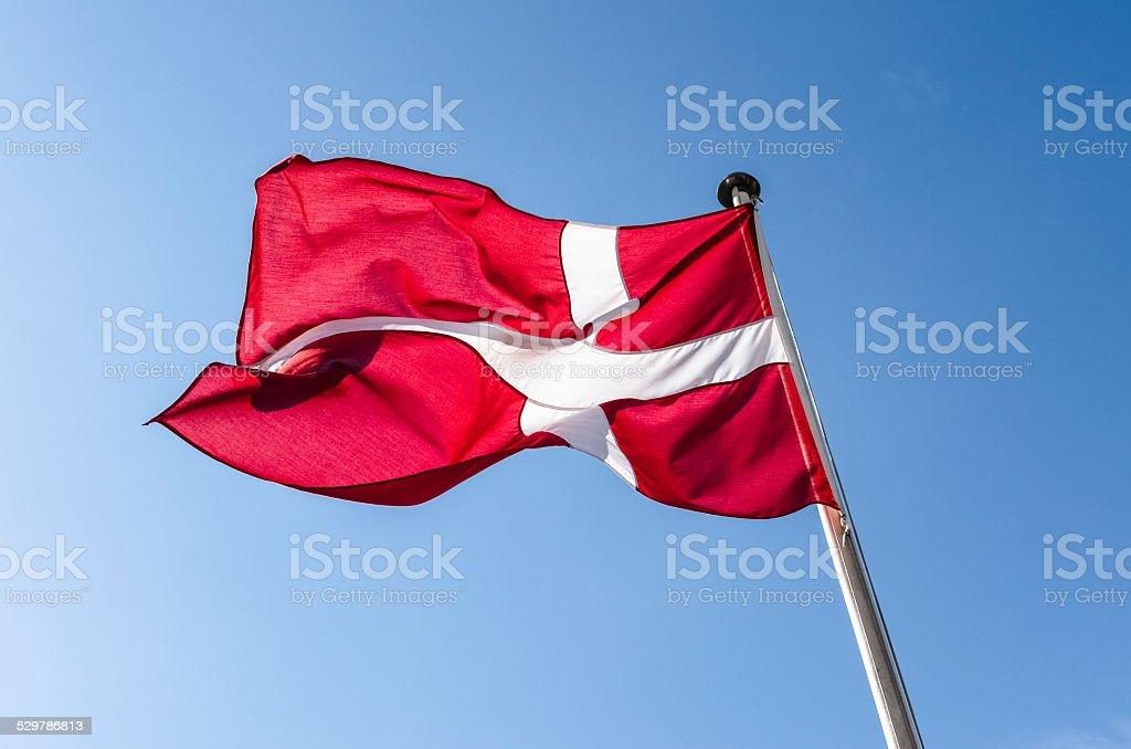 Danish flag waving in the sky of Copenhagen stock photo