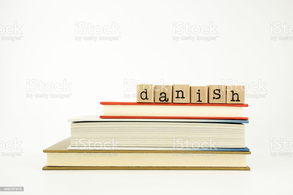 Danish language word on wood stamps and books stock photo