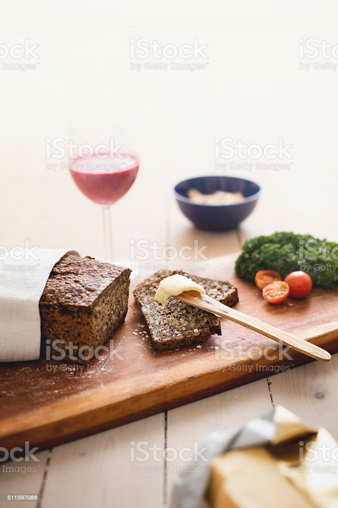Danish rye bread, with butter, smoothie and granola stock photo