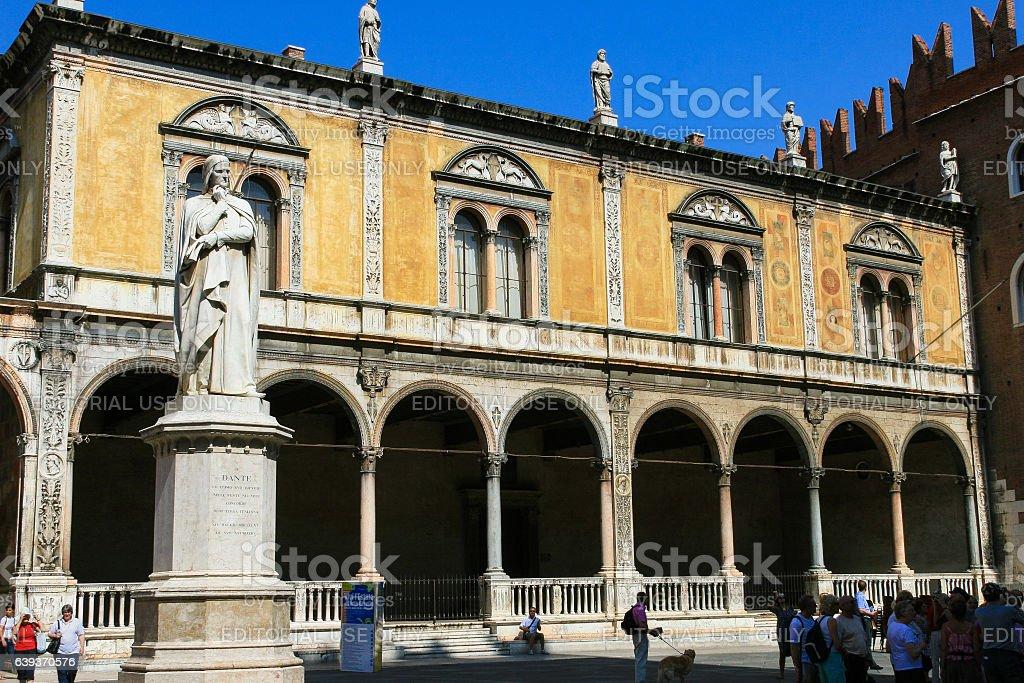 Dante Alighieri Monument and Tourists, Piazza dei Signori, Verona, Italy. stock photo