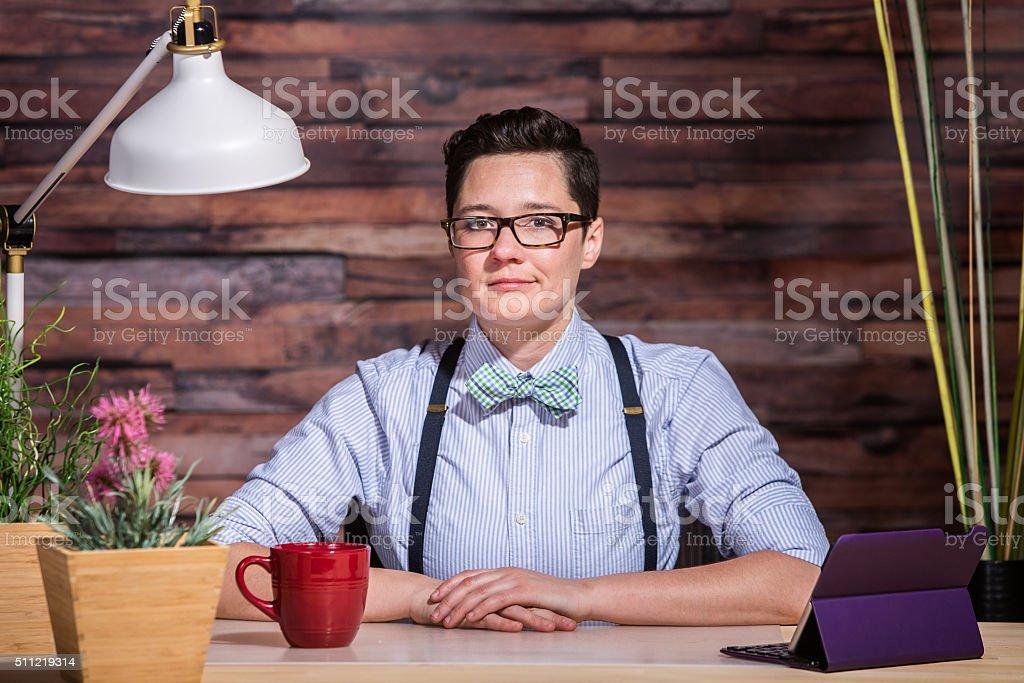 Dapper Woman With Coffee Mug stock photo