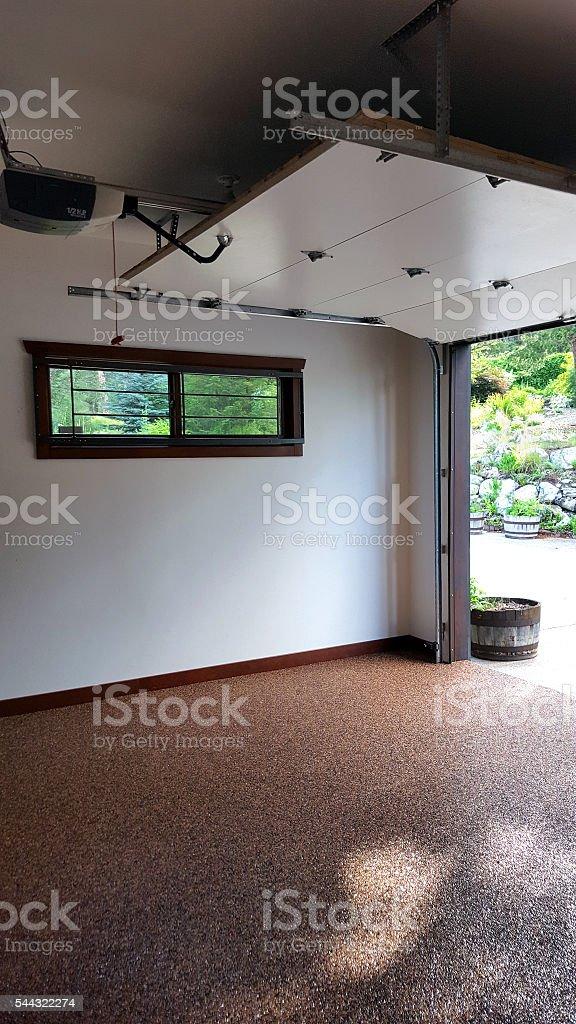 Dappled Sunlight On The Stone Epoxy Garage Floor stock photo