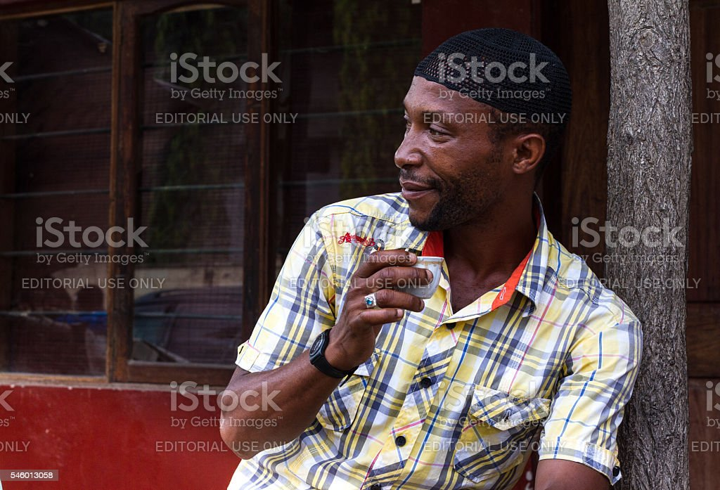 Dar es Salaam, Tanzania: Man Drinking Coffee (Close-Up) stock photo