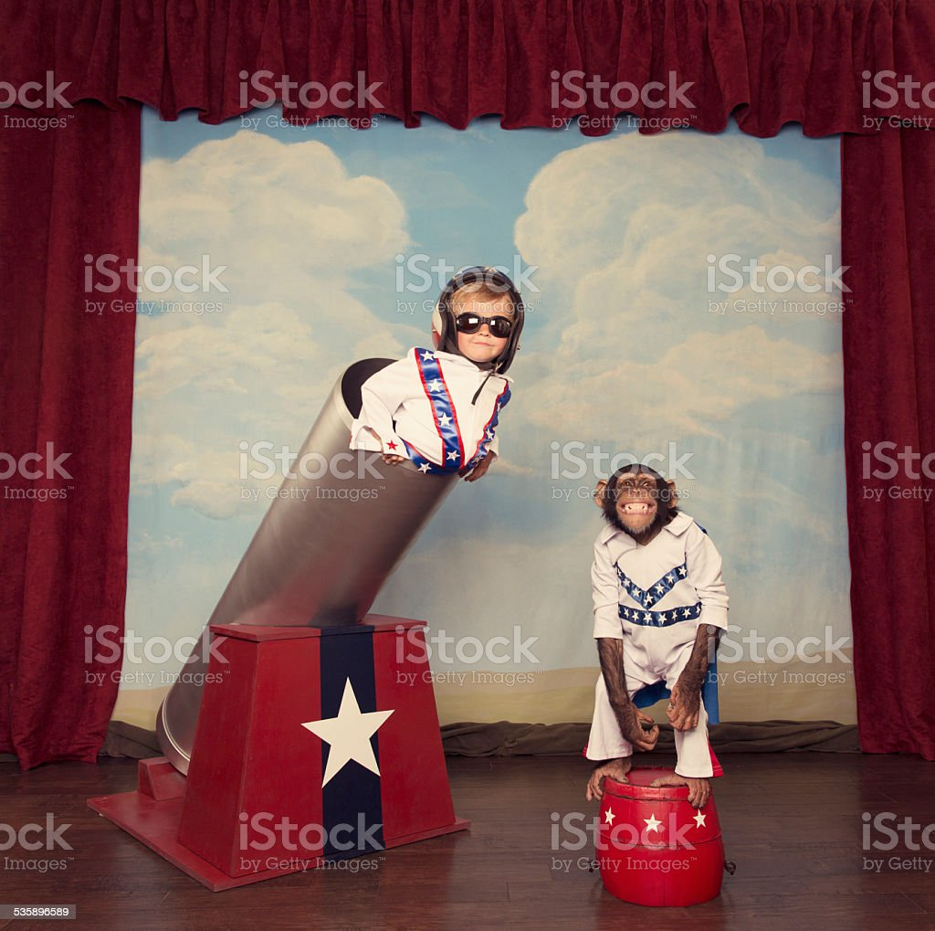 Daredevil Child and Chimpanzee Team with Cannon stock photo