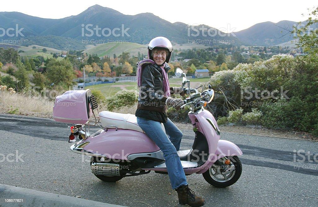 daredevil senior lady on a mortorbike royalty-free stock photo