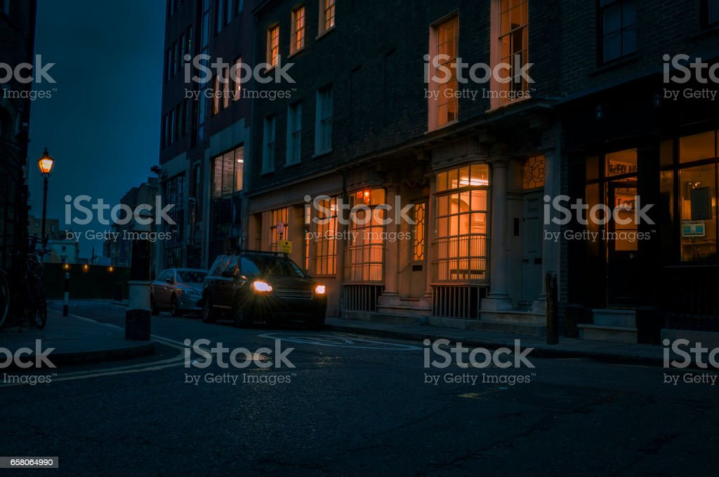 Dark alley at night in London stock photo