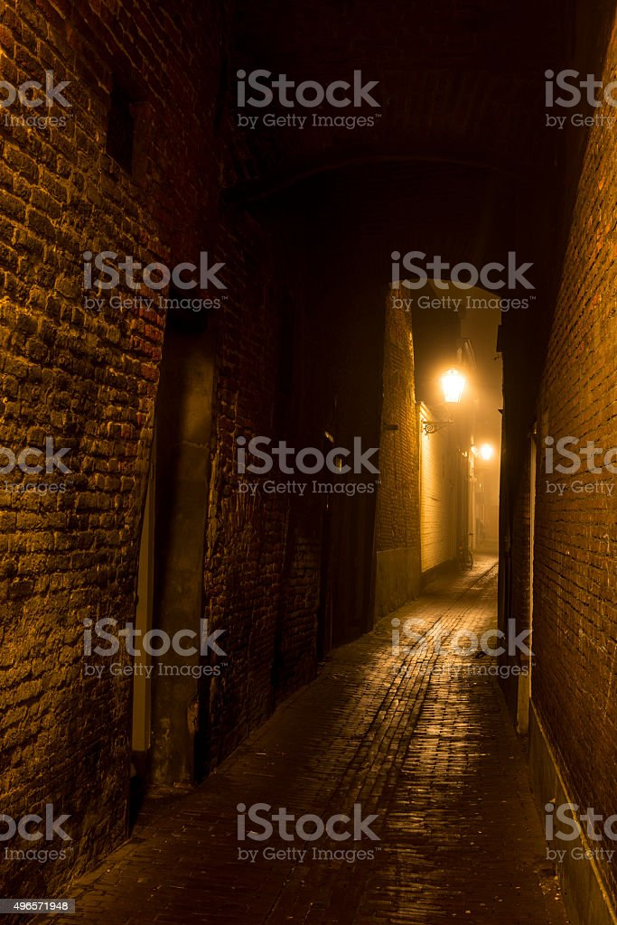 Dark alley during a foggy night stock photo