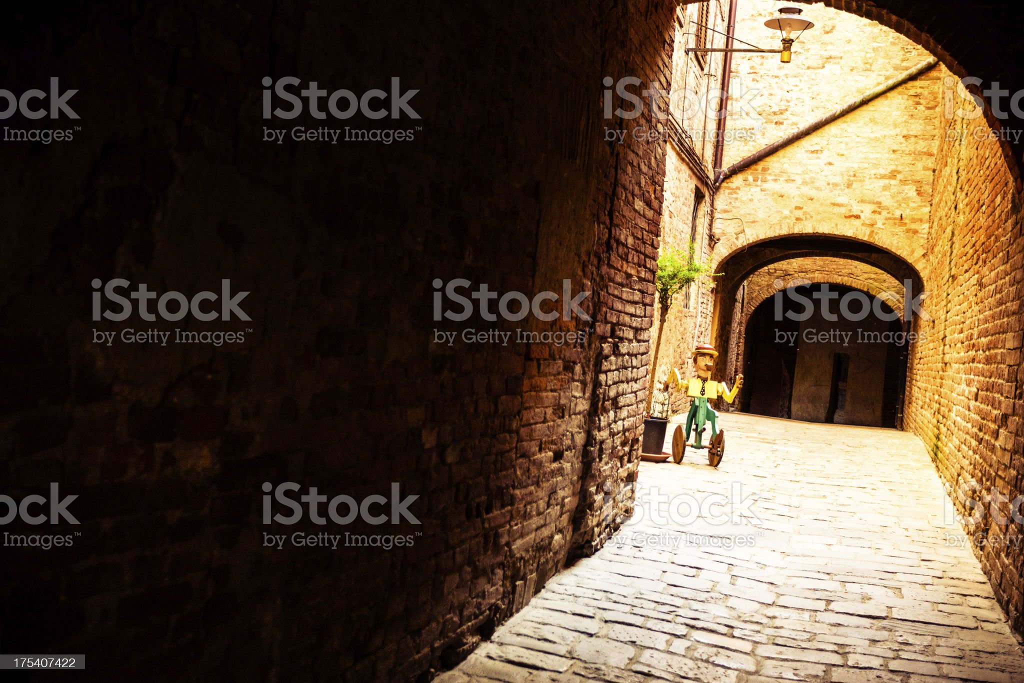 Dark Alley in Medieval Town of Tuscany, Italy royalty-free stock photo