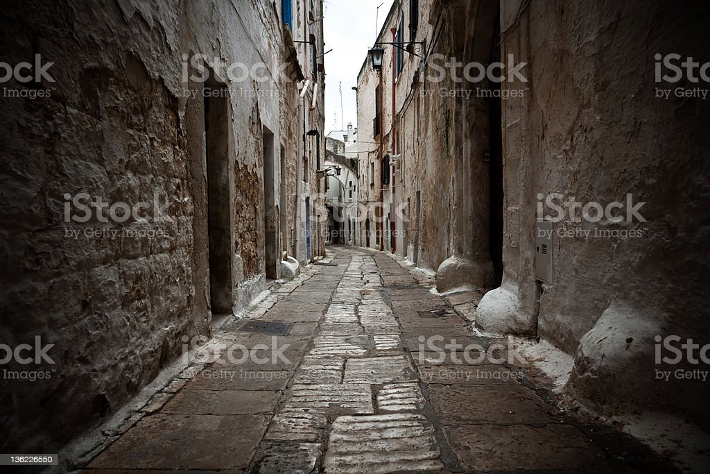 Dark Alley, Ostuni Village in Apulia Italy stock photo