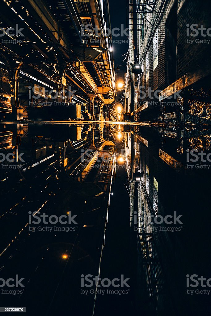 Dark alley reflected in puddle. Wicker Park, Chicago. stock photo