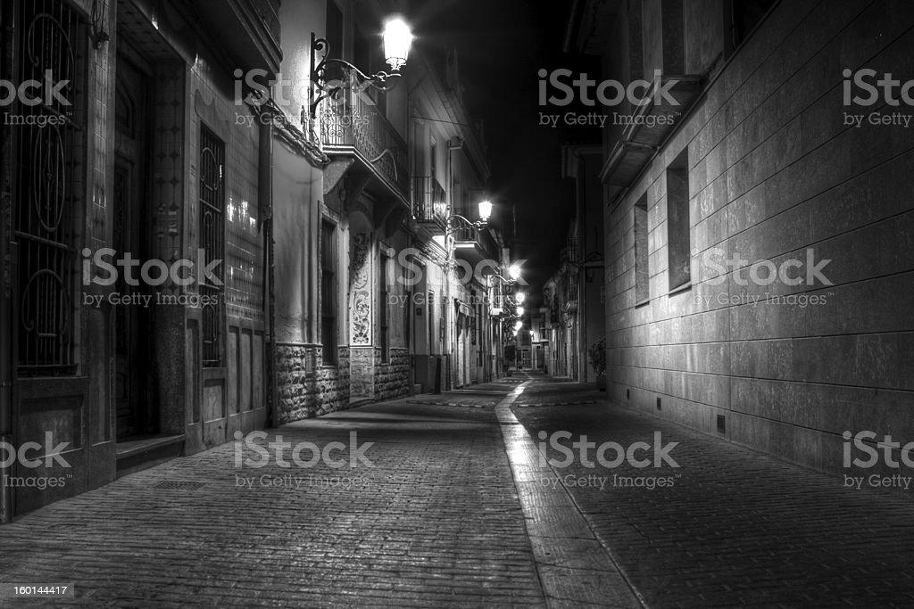 Dark alleyway between buildings at night stock photo