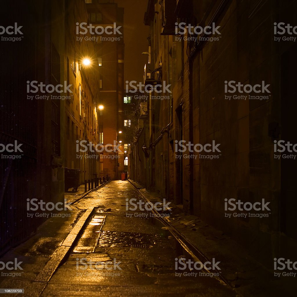 Dark Alleyway with Light in Downtown Glasgow stock photo