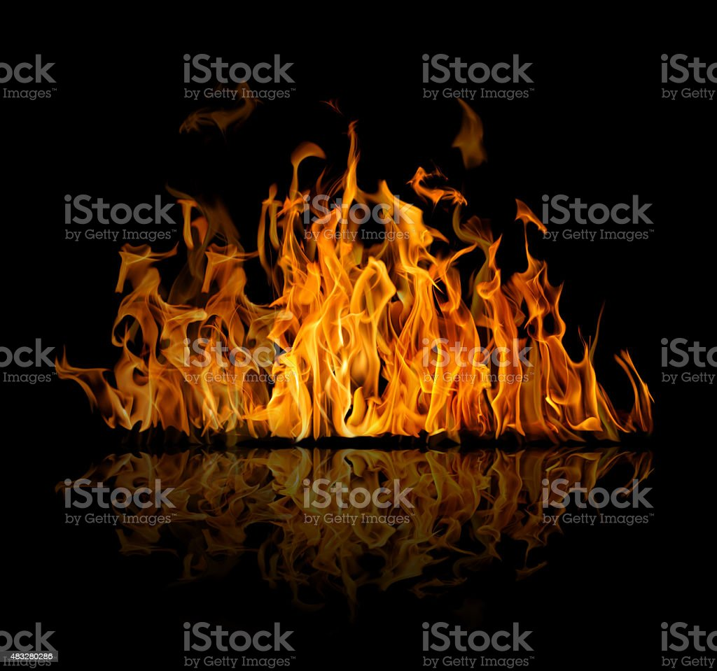 dark and bright orange fire on black with reflection stock photo