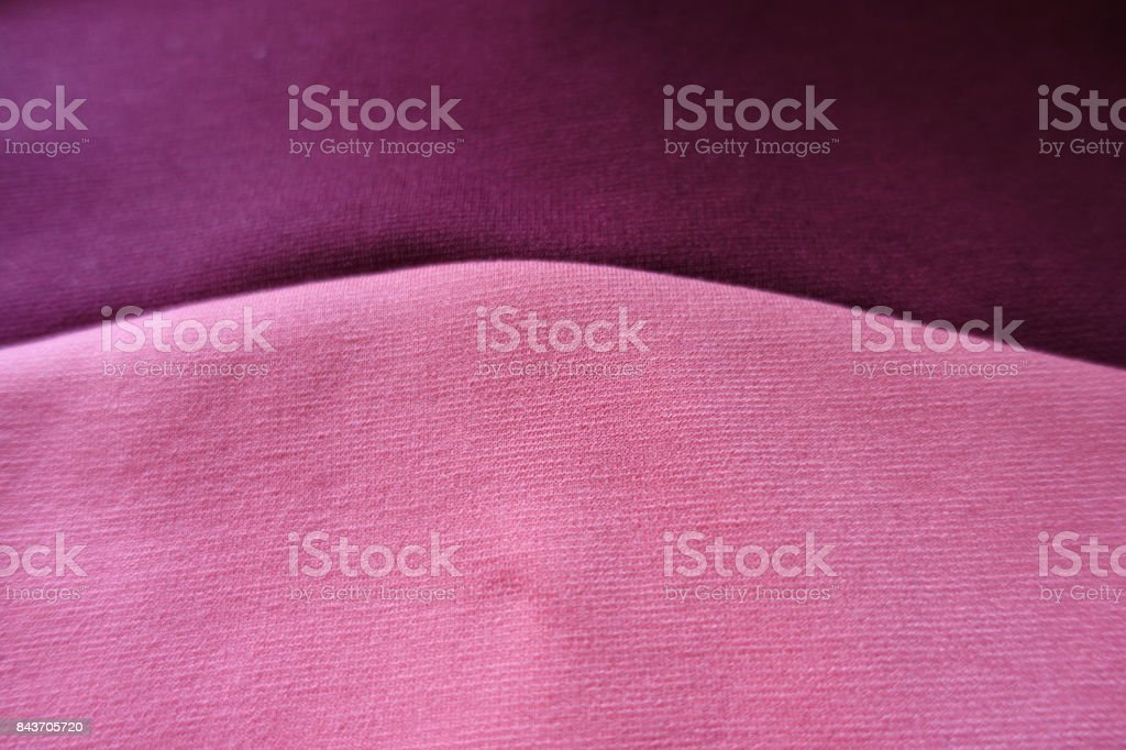 Dark and light pink fabric stitched in semicircle stock photo