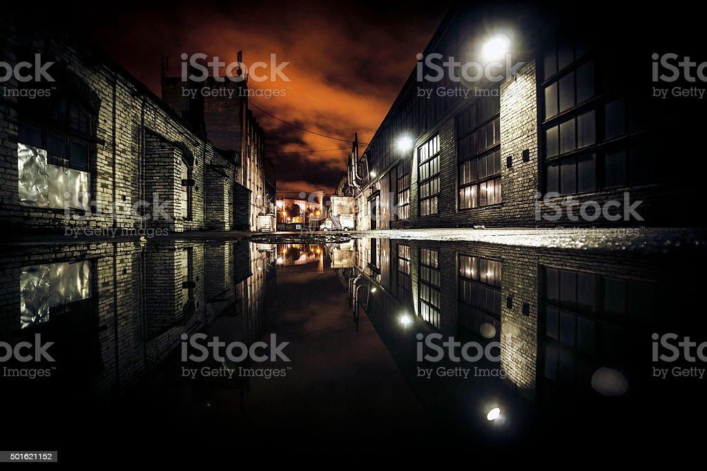 Dark backstreet reflections. stock photo