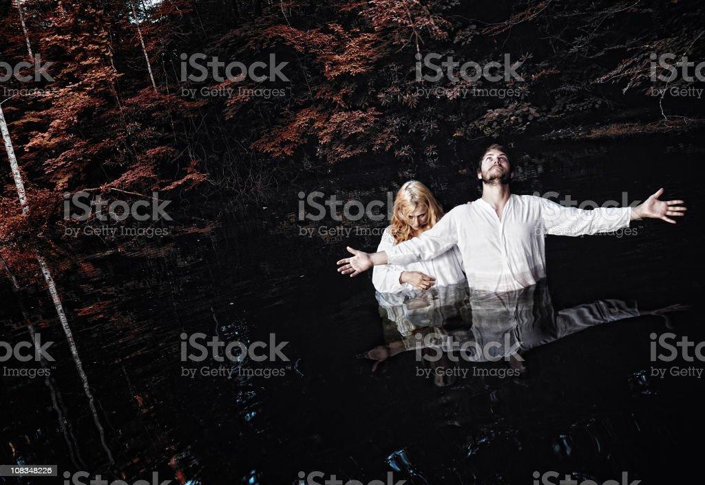 Dark Baptism stock photo