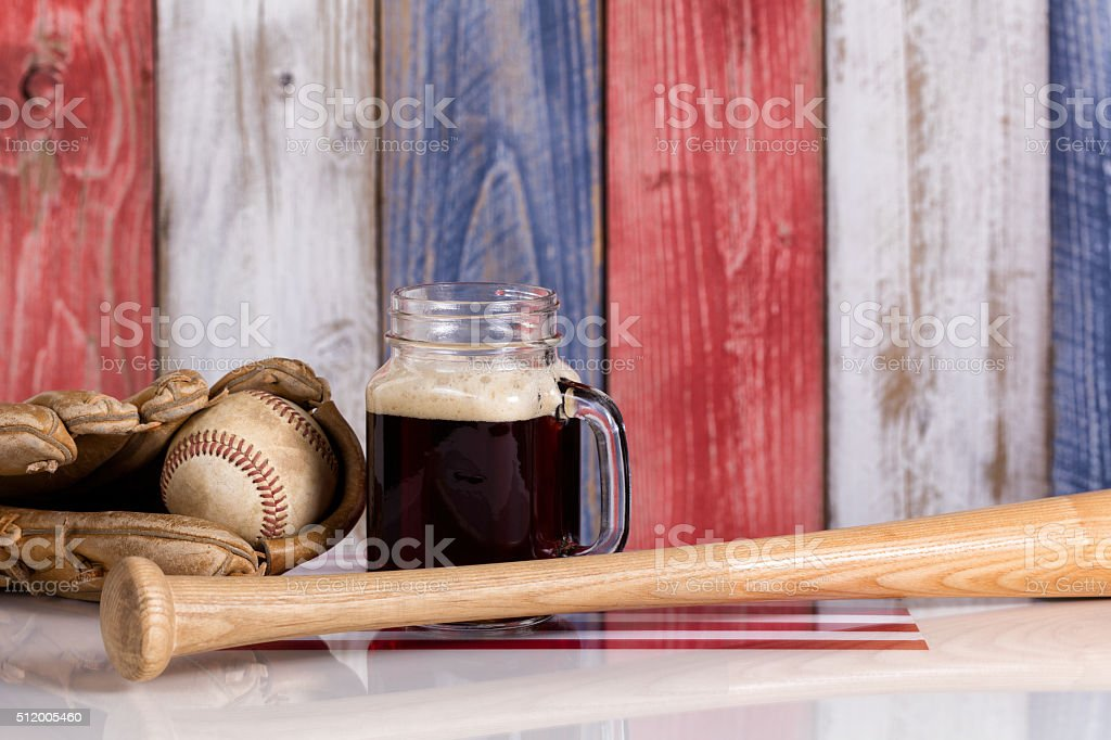 Dark beer and baseball stuff with faded wooden boards stock photo
