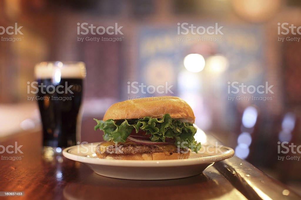 Dark beer and cheeseburger stock photo